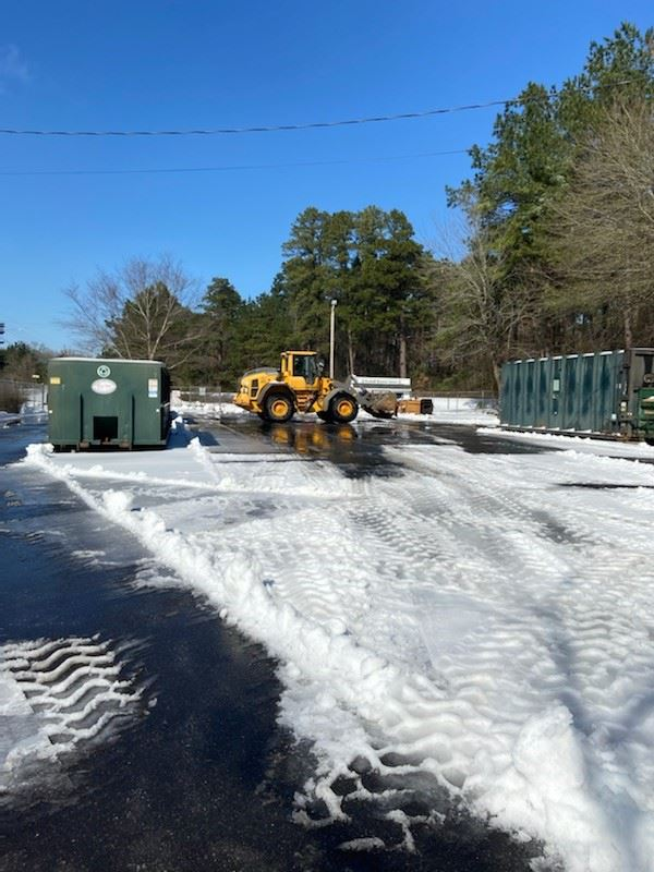 compactor site being cleared of ice